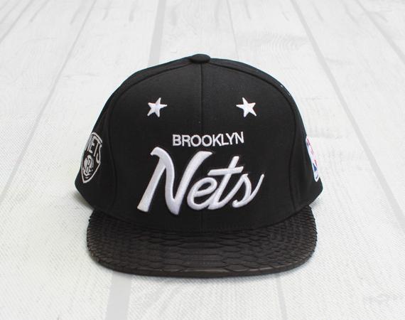 best service 9fc0b 95d52 ... best price mitchell ness x just don brooklyn nets black python snapback  cap bea16 424c0